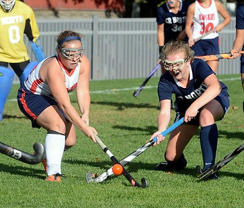 Elayno Curtin (22) and Marykate Dugan (19) battle in front of North goal.