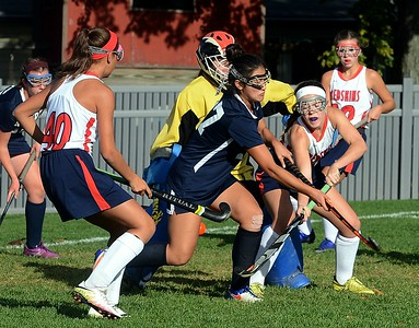Kayla Connelly (10) flips ball by North defenders.