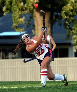 Emily Alexis (16) flips ball upfield.
