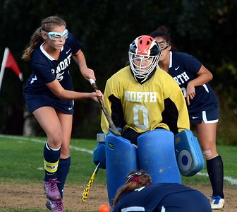 Julianne Mangano (5) and margaret D'Auria (0) guard North goal.