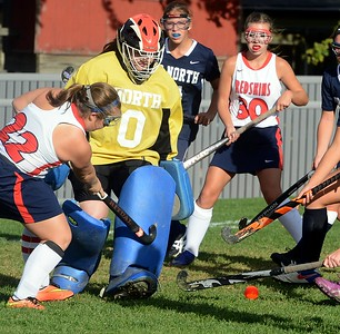 Elayno Curtin (22) tries to drive the ball by goalie Margaret D'Auria (0).