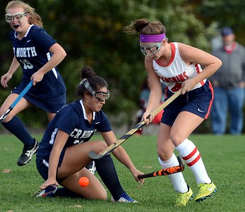 Mia Sexton (4) drives by a fallen Hannah Barsky (27).