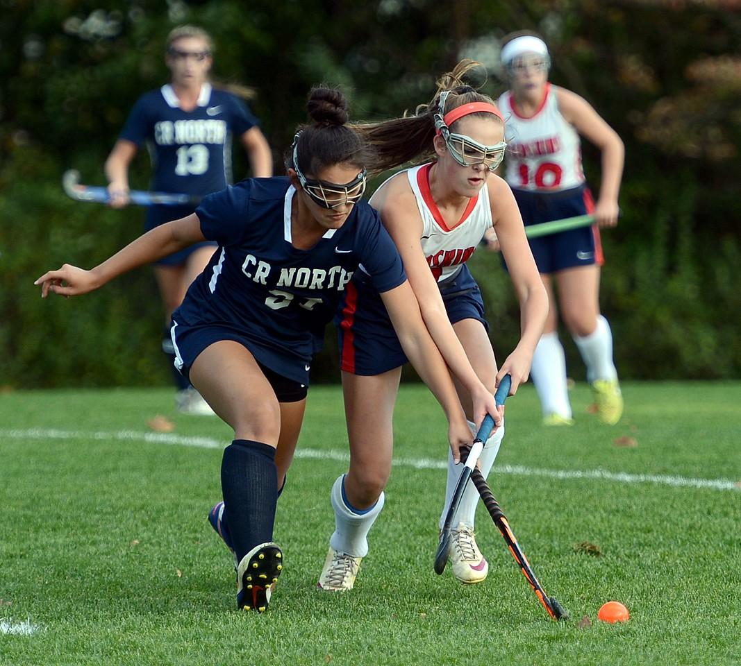 Abby Geisler (8) and Hannah Barsky (27)) race to the ball.