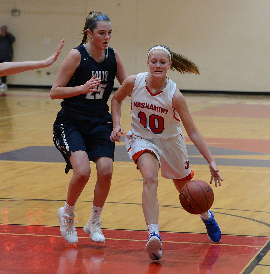 Emily Tantala (10) drives by Olivia Boyle (25).