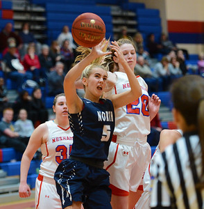 Camryn Polinsky (5) and Brooke Mullin (20) battle for free ball.