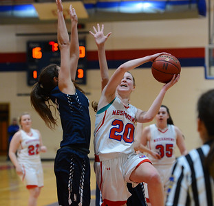 Brooke Mullin (20) drives against Dana Bandurick (15).