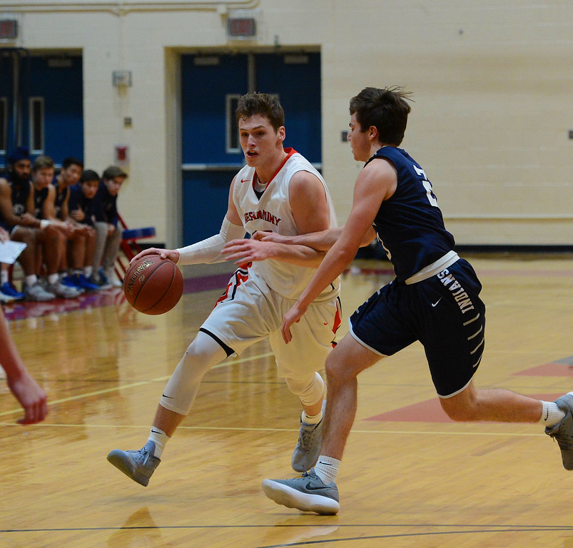 . Chris Arcidiacono (15) heads for the hoop.