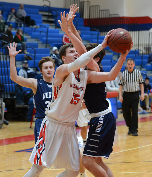 Chris Arciadiacono (15) is fouled on way to basket.