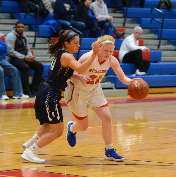 Kristin Curley (21) tries to drive by Becca Margolis (43).