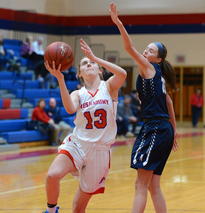 Olivia Scottie (13) drives by Sydney Blum (20).