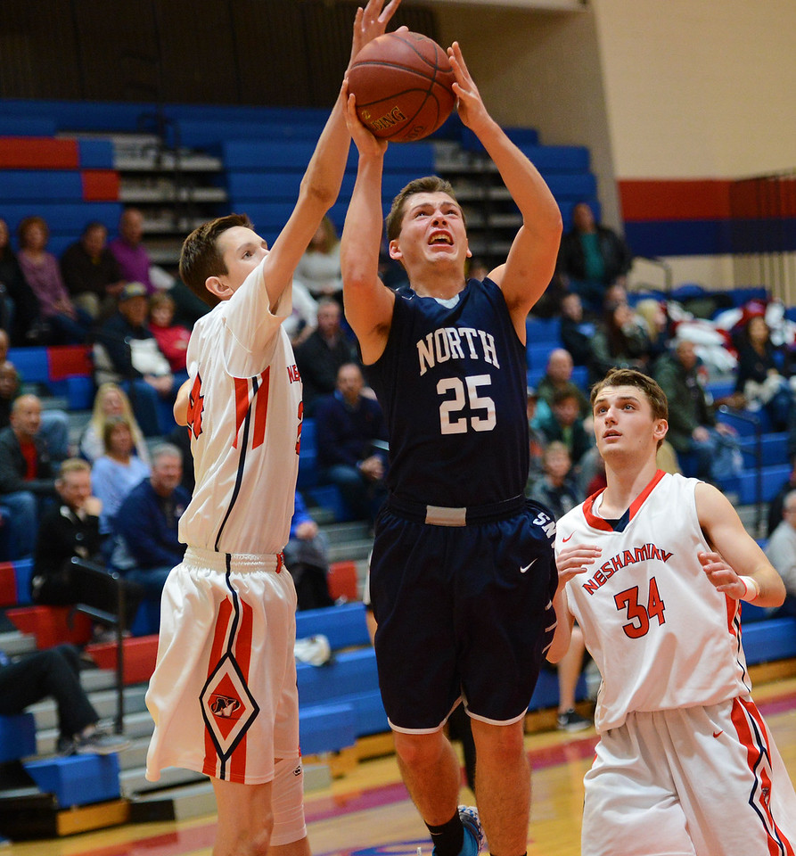 James Duffy (25) drives hard to the hoop.