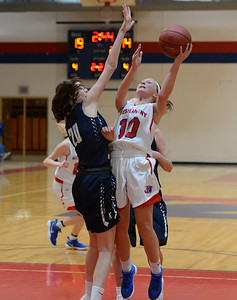 Emily Tantala (10) drives against Sydney Blum (20).