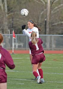 Nicole Palmer (11) heads ball upfield.