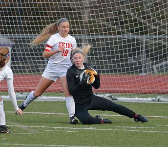 Jackie Ziegler (18) pressures Mifflin goalie.