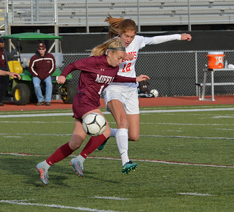 Hannah Stonkus (12) battles Kiery Spatz (1) for possession.