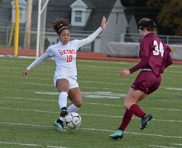 Michaela Boyd (10) captures ball in front of Hailey Payne (34).