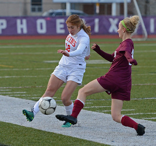 Hannah Stonkus (12) gets ball by Mifflin defender.