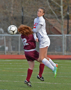 Genna Obringer (13) collides with Hannah Teson (32) going for header.