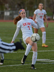 Gina Sexton (7) advances the ball upfield.