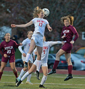 Brooke Mullin (17) gets off a header.