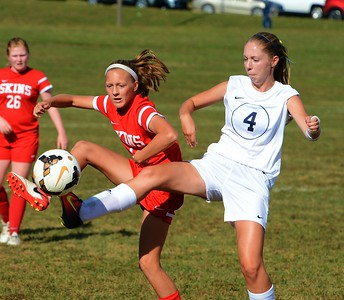 Neshaminy's Emily Tantala (4, left) and Council Rock South's Caroline Doyle (4) battle for possession.