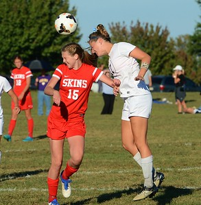 Brooke Mullin (15) and Kasey Schlupp (17) go for a header.