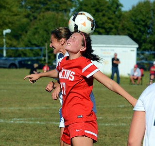 Riley Nyhus (17) battles to win headball.