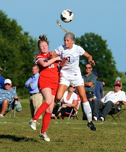 Grace O'Kane (7) battles Kristin Curley (26) for headball.