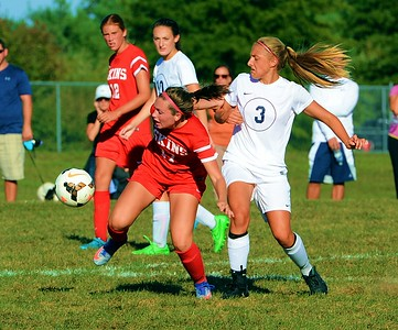 Riley Nyhus (17) battles Julie Rebh (3) for possession.