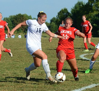 Jesse Magee (16) keeps Nicole Palmer (11) from the ball.