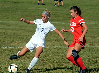 Grace O'Kane (7) clears the ball upfield for the Golden Hawks as Brianna Tobin  (23) defends for Neshaminy.