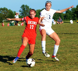 Neshaminy's Riley Nyhus (17) and CR South's Lily Dura (2) sail to the ball in Sept. 27 matchup between the schools.