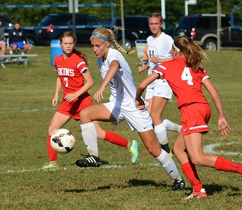 Grace O'Kane (7, center) gains control of the ball for CR South.