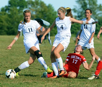 Council Rock South's Kylie Rayher (11) and Caroline Doyle (4) keep ball from Neshaminy's Riley Nyhus (17).