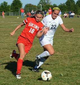 Jackie Ziegler (18) and Maria Buonomo (22) race to the ball