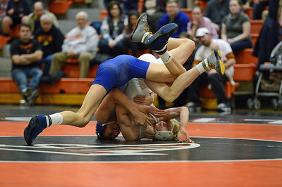 Pennsbury's Antonio Martoccio and Neshaminy's Jackson Erb clash in exciting finale to the match between the Falcons and the Skins Jan. 17 at Pennsbury.    (John Gleeson – 21st-Century Media)