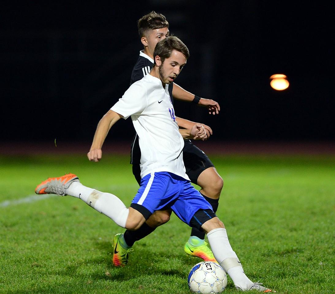 Neshaminu junior Zach Miller (14) gets a good leg into the ball.