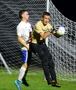 Truman goalie Dawson Black, right, protects ball from Nick Lindsey (13).