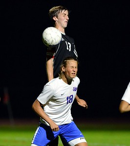 Emil Leplai (18) wins header from CJ Weed (13).