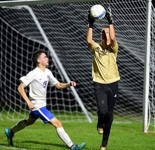 Nick Lindsey (13) charges Truman goalkeeper Dawson Black.