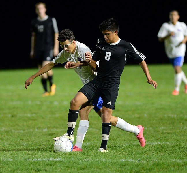 Chris Amaro (9) and Diego Rodriguez (8) collide going for the ball.