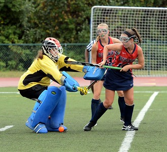 CR North goalie Margaret D'Auria blocks Kayla Connolly's (#10) shot.