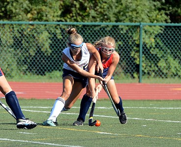 Neshaminy's Sophie Schardt (#23) battles CR Souths Katelyn Cocco (35) for possession.