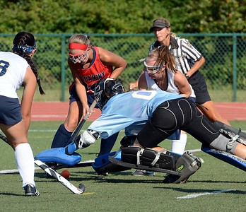 Neshaminy's Peyton Ritchie (30) tries to get ball by a diving Sabrina Masone.