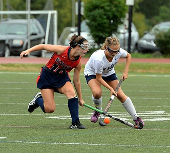 Neshaminy's Kayla Connolly (#10) and CR North senior Anna Lehman (7) battle for the ball.