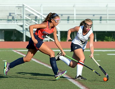 Neshaminy's Janie Pennington (40) races CR South's Sarah Womer (6) to the ball.