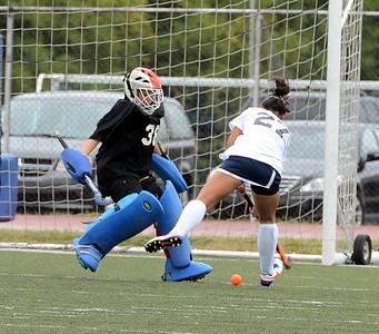 Neshaminy goalie Jill Mitchell (#38) blocks Hannah Barsky's (#27) shot.