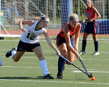 Neshaminy's Elena Donato (#15, right) beats Paige Schmid (12) to the ball.