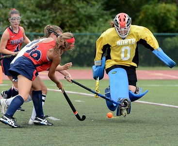 Peyton Ritchie (#30) tries to get ball by Rock goalie Maragret D'Auria.