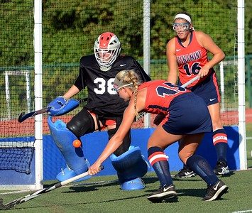 Neshaminy goalie Jill Mitchell joins Elena Donato (15) and Emily Alexis (16) to block shot on goal.